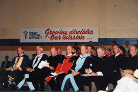 Administrators and faculty in academic regalia