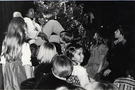 Children listening to a story at a Christmas Banquet