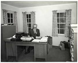 Registrar Enoch E. Mattson at his desk