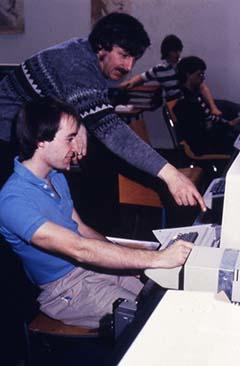 Faculty member Dr. Van Dyke assisting a student in class.