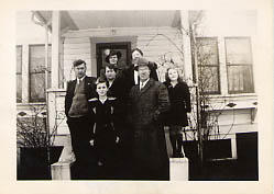 The Odland family posing in front of their house