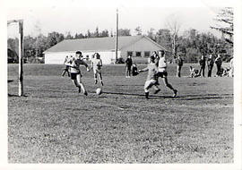 Students playing soccer outside
