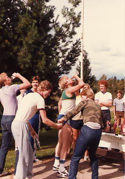 Students drinking pop near the flag pole during The Challenge