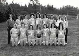 Women's basketball team posing in uniform with coach