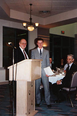 Brad Jacobson receiving an award