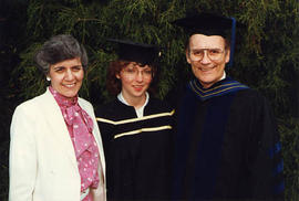 Speaker posing with his daughter and wife after graduation