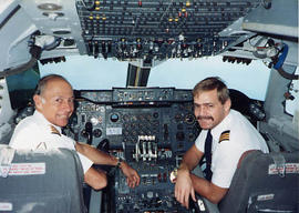 Bob and Brian Gartshore posing together in the flight deck of a 747
