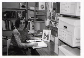 A contract archivist at her desk