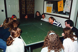"Students playing ""air ping-pong"" on a retreat"