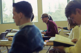 Slide 30 - students in a classroom