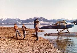 Three aviation students with a float plane