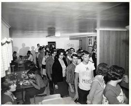 Students lining up for a meal in the dining area of Seal Kap