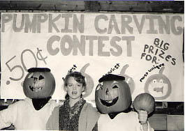 Students at a pumpkin carving contest during the Harvest Fest