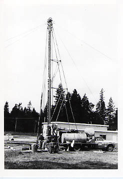 Drilling rig near the maintenance shed
