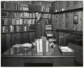 President Calvin B. Hanson standing in his office