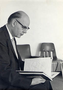 Robert Snyder seated on a chair