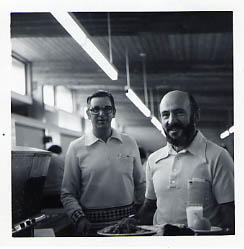 Two staff members in the cafeteria