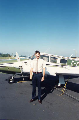 Aviation instructor posing in front of an airplane