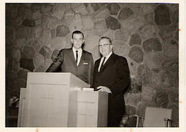 Calvin Hanson standing with a guest speaker