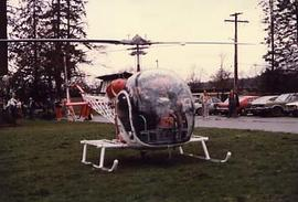Dr. R. Neil Snider arriving in a helicopter
