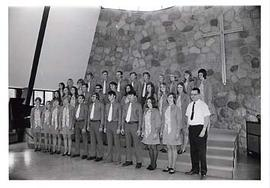Choir standing on stage in the chapel