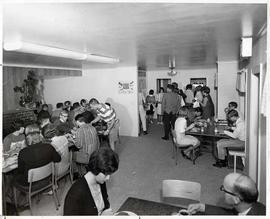 Students and staff seated at tables during mealtime