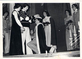 Retiring king crowning new king during Homecoming 1977