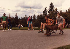 Students in a wheel-barrow race during The Challenge