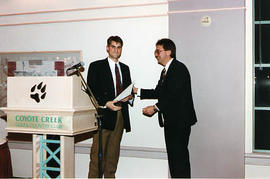 Dale Wilson presenting an award to an aviation student