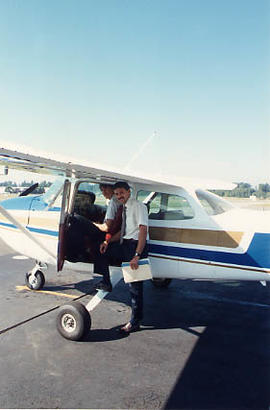 Aviation instructor standing next to an airplane