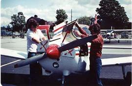 Two aviation students working on an aircraft