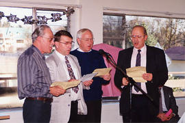 Male quartet singing at Bruce Traub's retirement party