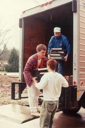 Allan Kotanen and two student workers unloading  the card catalogue