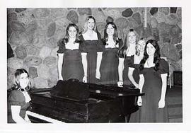 A women's sextet posing in the chapel