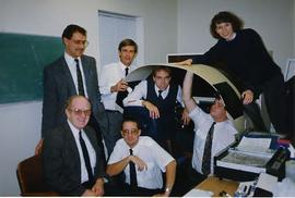 Aviation instructors posing with simulator