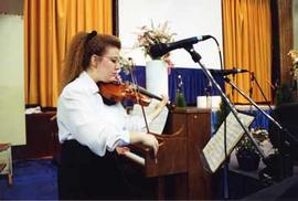 Student playing her violin at the Dessert Evening