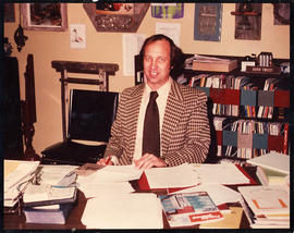 David Twiest sitting at his desk