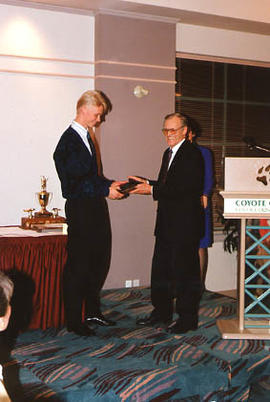 Timo Kostamo receiving an award