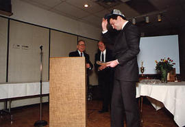 Robert N. Thompson presenting an award to Dan Rawlyck