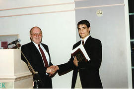 Ivan Pettigrew presenting an award to an aviation student