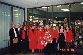 Various staff posing together on Dress Red Day