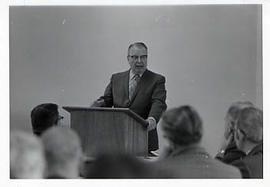 Dr. Arnold T. Olson speaking
