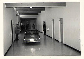 A convertible sportscar parked in a hallway