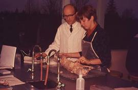 Faculty member Richard Walters assisting a student with their science experiment.