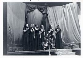 A women's sextet performing in the gym