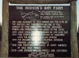 Close-up of the Hudson's Bay Farm sign located at the McMillan Park Rest Area