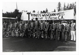 Cyclists under the banner for the Trinity Western Wheels