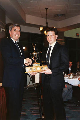 Greg Brown receiving an award