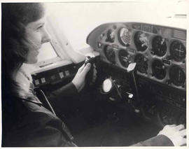 Student Joyce Alloway at the controls of a plane