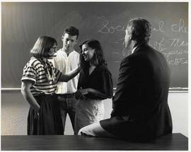 Craig Seaton and Barbara Pell with two students